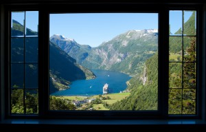 view trough a window to geiranger fjord in norway